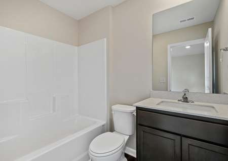 The master bath has a beautiful vanity and a shower/tub combo.