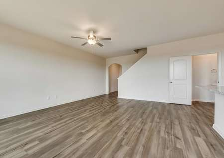 The family room has a ceiling fan and luxury vinyl plank flooring.