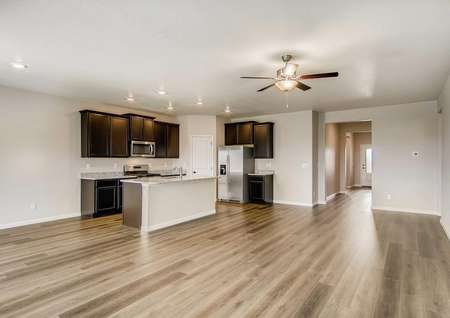 Wide view of the living room,kitchen and dining area in the Pike floor plan.