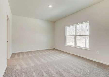 Master bedroom with a large window