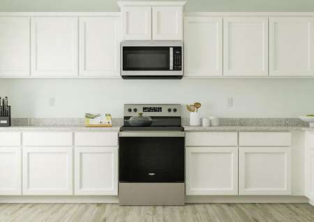 Rendering of kitchen area with large   granite countertop space with view of microwave and oven.