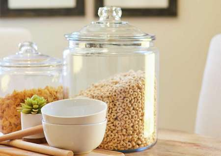 Trace kitchen jars with cereal, noodles, and white bowls