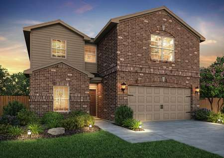 Artist rendering of the Driftwood by LGI Homes at dusk, in brown brick and tan siding with front yard landscaping and fence visible..