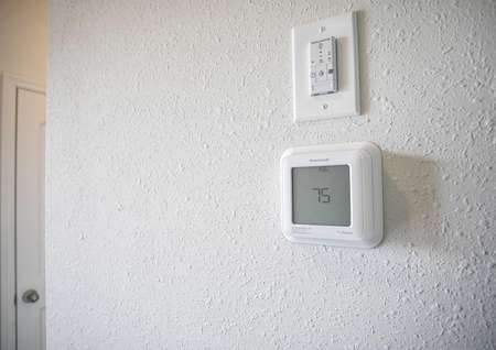 Harriet  completed model home featuring digital / programmable thermostat on white painted wall