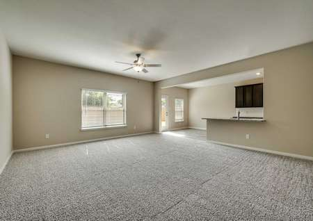 The spacious downstairs living room inthe Oakmont floor plan.