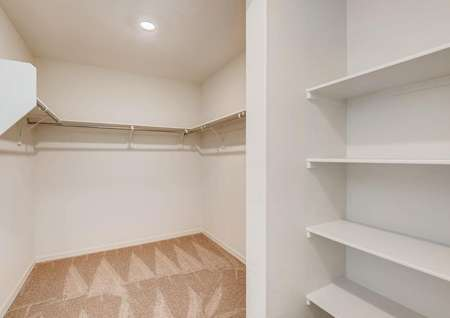 A walk-in closet connected to the master bedroom features plenty of storage space.