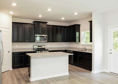 The Mid Atlantic Jordan kitchen with the granite kitchen island as the focal point.