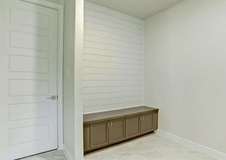 Mud room area with a charming shiplap wall.
