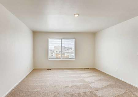 Yale bedroom with soft carpeting, two floor vents, and large window with blinds