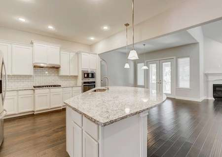 Timberline kitchen with white cabinets, wood floors, and light color granite counters