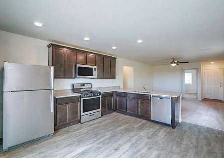 Kitchen with stainless steel appliances, wood-like flooring, granite countertops