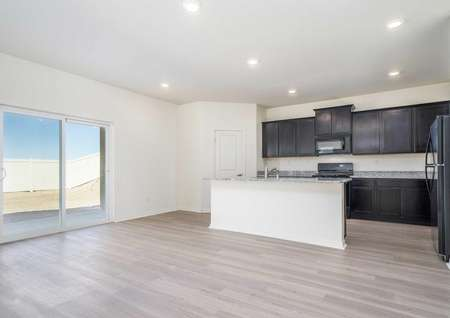 Redondo kitchen with recessed lights, custom Cabinetry, and granite countertops