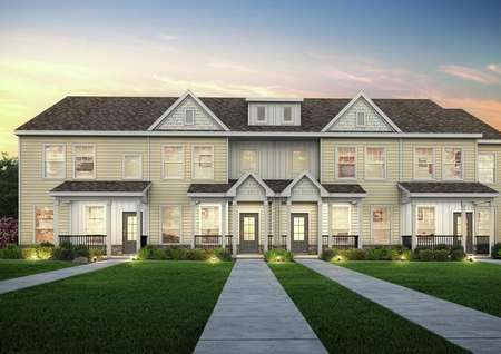 Straight on view of the Huntington Point townhomes at dusk