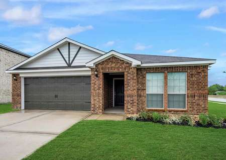 Exterior view of the Topeka model with brick siding, two car garage, shingle roof and professionally landscaped front yard