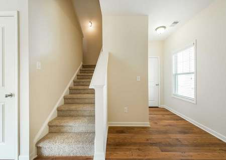 Vinyl wood-style flooring in the hallway and carpeted stairway of the Chatuge floor plan