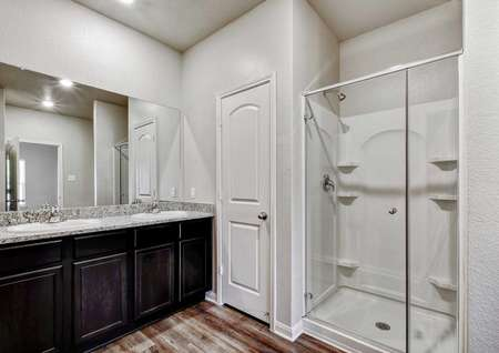 Victoria bathroom with walk-in shower, gray granite counters, and dark brown cabinet for the  vanity
