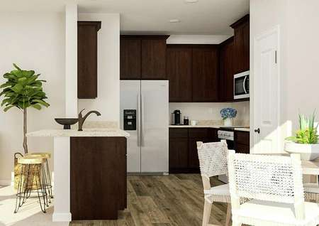 Rendering of the view into the kitchen   from the dining area. The kitchen has large wood cabinets, a stainless steel   refrigerator with ice maker and a breakfast bar. The media center of the   living room is also visible.