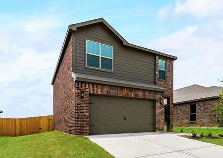 This home has a luxurious brick exterior paired with dark gray siding.