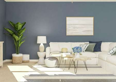 Rendering of the   living room showing the blue accent wall, white sectional couch, coffee table   and mounted tv.