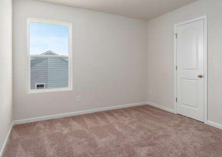 Avery plan room with bay window, brown carpeted flooring, and walk-in closet