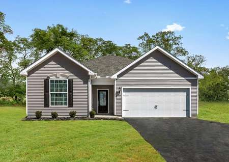 Front exterior photo of the Martin plan by LGI Homes with gray paint, white trim, black shutters, oversized lot.