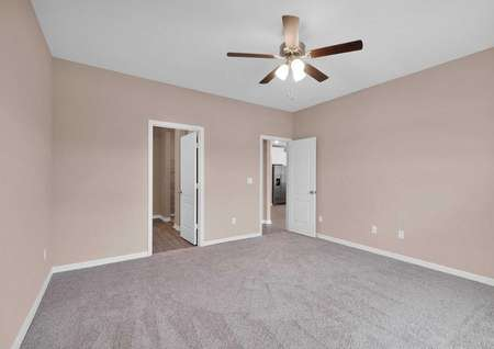 The master bedroom hosts its own full bathroom and walk-in closet.