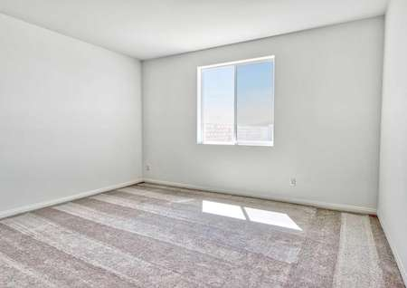Aster bedroom with light brown carpet, white on grey walls, and white framed window