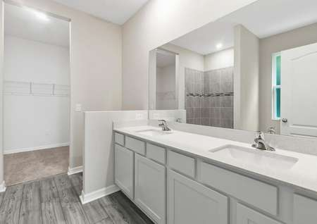 The master retreat features its own full bathroom with a double-sink vanity, a step-in shower and a sizable walk-in closet.