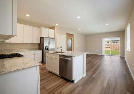 The kitchen overlooks the family room in this layout.