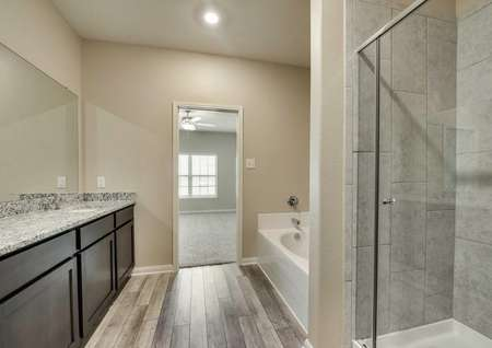 Oakmont floor plan's bathroom with a separate shower and bathtub onthe same wall.
