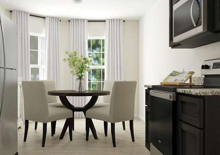 Rendering of dining   area with light wood look flooring, bay windows and cream walls. Kitchen is   visible in the foreground.