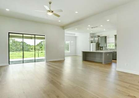 This home has a bright, open layout with large windows and wood flooring.