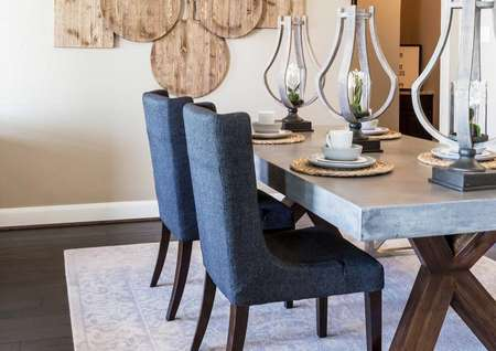 Dining room with dining room table, chairs, and rug.