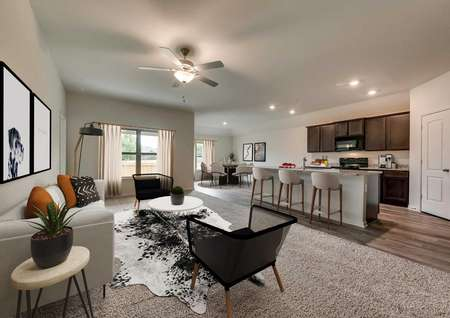 Interior of the Topeka model floor plan's furnished living room and kitchen.