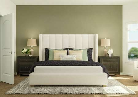 Rendering of owners bedroom with green   accent wall, large bed and additional seating.