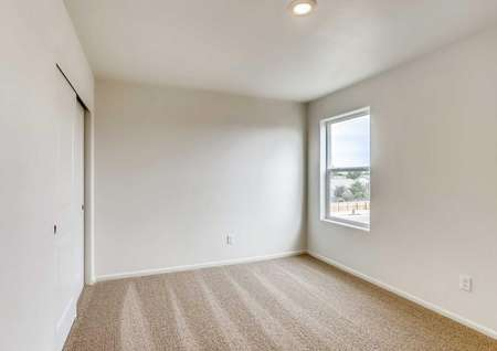 Harvard bedroom with recessed light, tan carpet, and white trim on off white walls