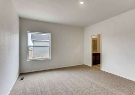 Princeton bedroom with floor heating, carpeting, and recessed ceiling light