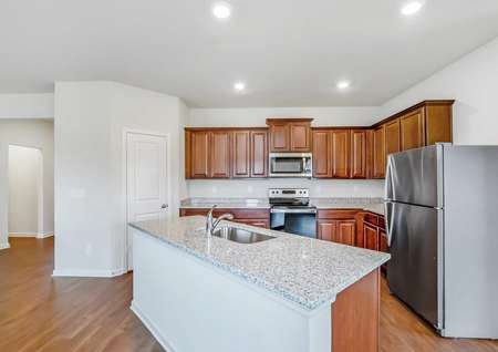 Chef-ready kitchen with spacious countertops and a full suite of appliances.