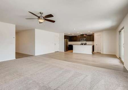 Carpeted family room, open kitchen and a sliding door that leads to the back yard.