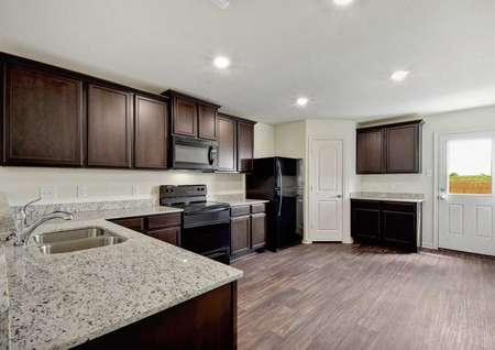 Hawthorn kitchen with hardwood flooring, canned lights, and light color granite counters