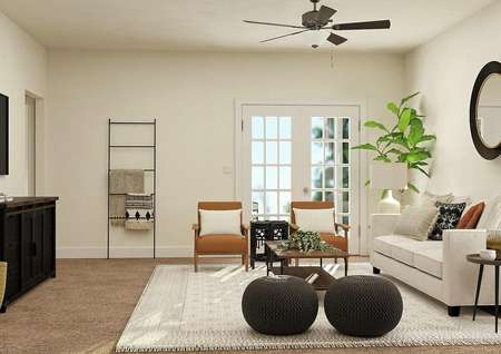 Rendering the spacious Maple living room with doors leading to the back yard, carpeted flooring and tan walls. Decorated with a couch, two armchairs, coffee table and entertainment center.