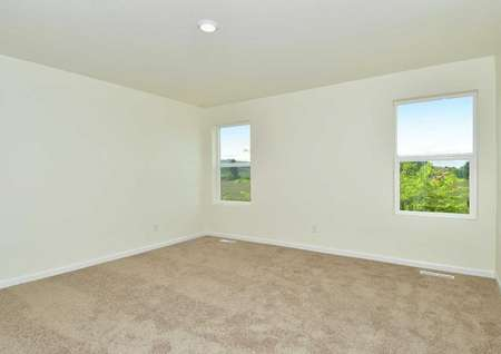 The Northwest Oak master bedroom shown carpeted with two windows.