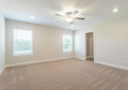 Craven master bedroom with recessed lights, ceiling fan, and carpet floors
