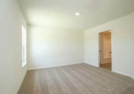 Trinity master bedroom with carpet and flooring, overhead recessed lighting, and access to private bathroom