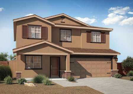 The 2-story Cimarron floor plan with a 2-car garage, professional landscaping, tan paint and brick detailing.