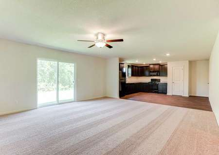Chippewa floor plan with brown carpets, overhead ceiling fan, and white sliding patio door