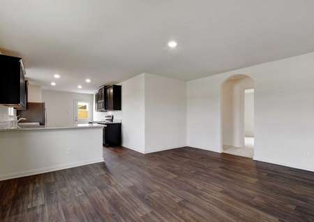 Medina kitchen area and dining nook with ceramic flooring, recessed lights, and dark wood custom cabinets
