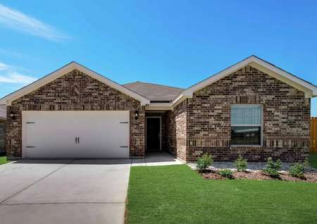 Sabine single-story house with multi-colored brick finish, green grass, and two-car garage