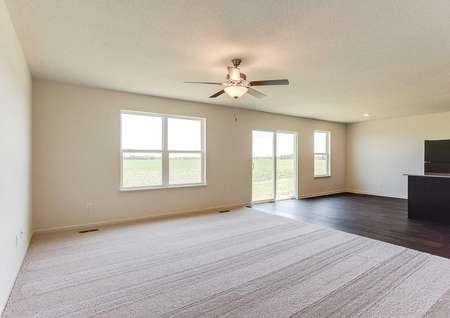 Hennepin great room with carpeting in the family room, hardwood floors in the kitchen and dining nook, and overhead ceiling fan