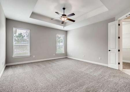 Timberline finished home with dark ceiling fan, grey carpet, and white on grey walls